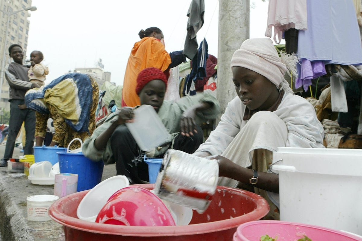 Sudanese refugees in Cairo 20 December 2005 [KHALED DESOUKI/AFP via Getty Images]