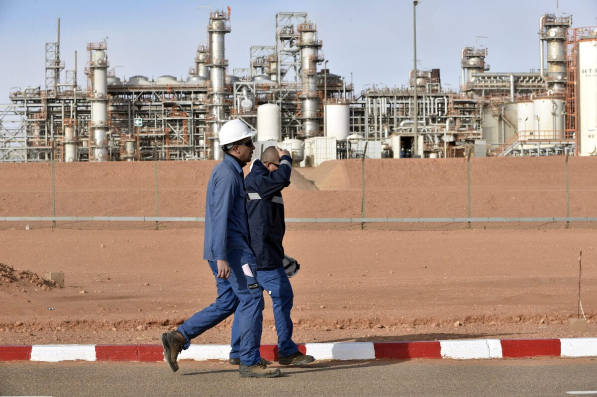Two orkers seen walking at the gas plant in In Amenas, Algeria on January 16, 2018 [RYAD KRAMDI/AFP via Getty Images]
