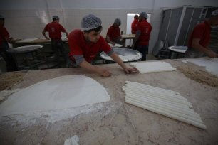 Work begins on ensuring Palestinians in Gaza have all the dessert they need to celebrate Eid Al-Adha 2020 in Gaza on 28 July 2020 [Mohammed Asad/Middle East Monitor]