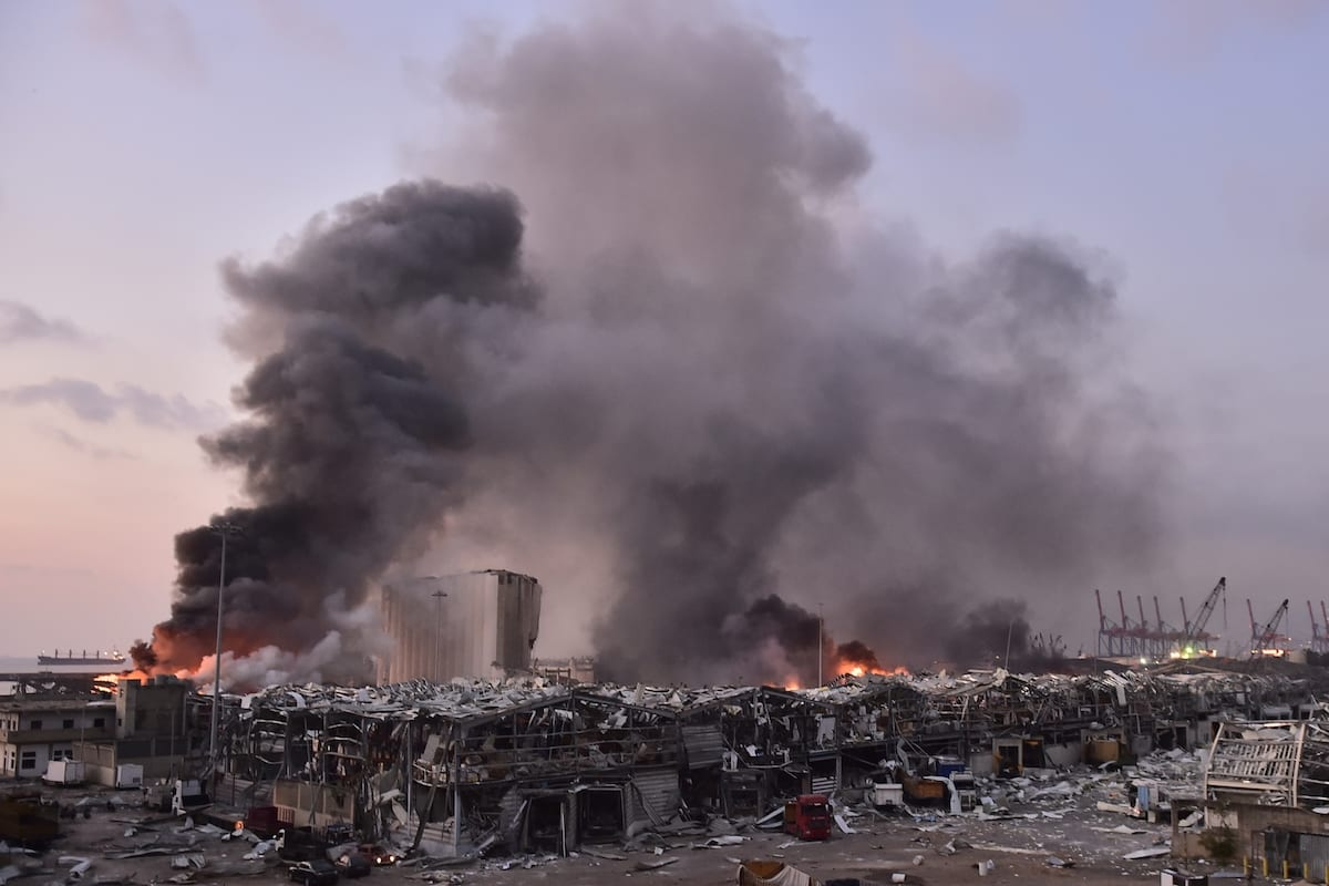 Smoke rises after a fire at a warehouse with explosives at the Port of Beirut led to massive blasts in Beirut, Lebanon on August 4, 2020. [Houssam Shbaro - Anadolu Agency]