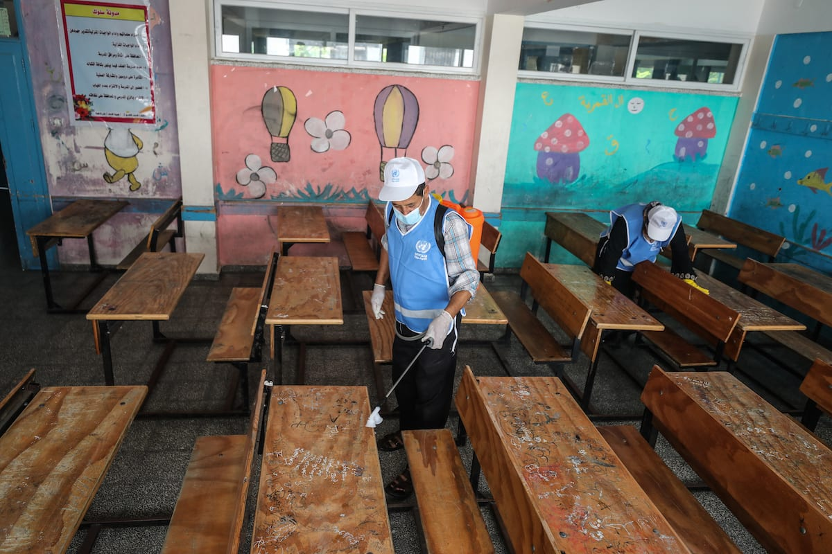 """UNRWA started sterilizing its schools inside the Gaza Strip, in preparation for the start of the new school year. Anadolu Agency correspondent reported that """"UNRWA"""" resumed, on Wednesday, the administrative time in all its schools and education departments, provided that school hours begin next Saturday morning on 5 August 2020 [Ali Jadallah/Anadolu Agency]"""
