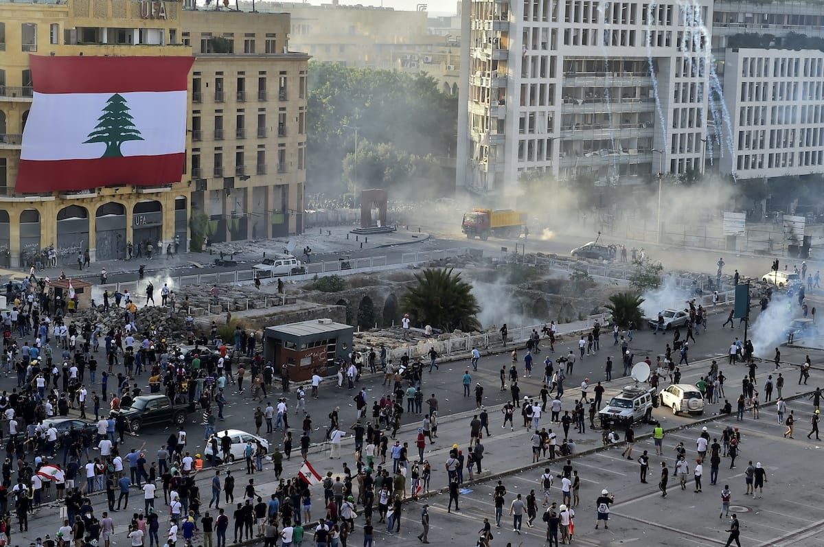 Demonstrators clash with Lebanese riot police as riot police intervene them with tear gas canisters during a protest against government at the Martyrs' Square after the deadly explosion at the Port of Beirut led to massive blasts on 4th August in Beirut, Lebanon on 8 August 2020. [Houssam Shbaro - Anadolu Agency]