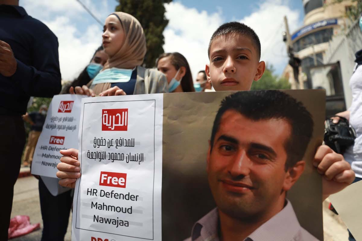 Palestinians in the West Bank protests for the release of Palestinian Coordinator of Boycott, Divestment and Sanctions movement (BDS) Mahmoud Nawajaa, detained in Israel on 11 August 2020 [İssam Rimawi/Anadolu Agency]