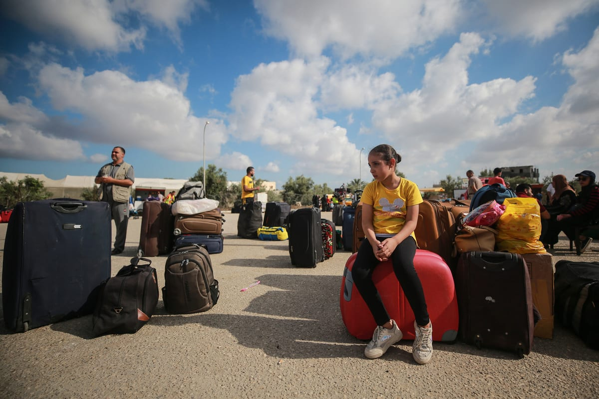 Palestinians wait before crossing the border after Egypt opened the Rafah crossing with the Gaza Strip for three days, in Rafah, Gaza on August 11, 2020 [Mustafa Hassona/Anadolu Agency]