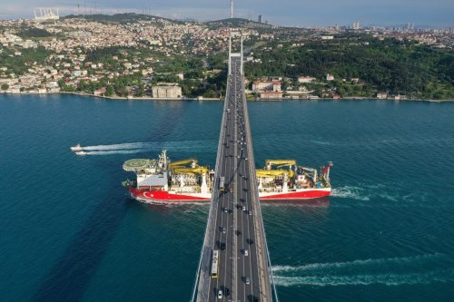 An aerial view of Turkish drilling vessel 'Fatih' passing under the July 15 Martyrs' Bridge as it is on the way, in Istanbul, Turkey on 29 May 2020. [Muhammed Enes Yıldırım - Anadolu Agency]