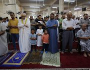Palestinians in Gaza perform Eid ul Adha prayers on 31 July 2020 [Mohammad Asad / Middle East Monitor]