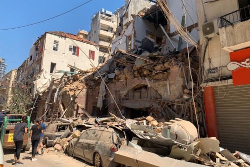 Damaged buildings and vehicles are seen in the aftermath of the Beirut port blast, on 5 August 2020. [Jessica Purkiss/Middle East Monitor]