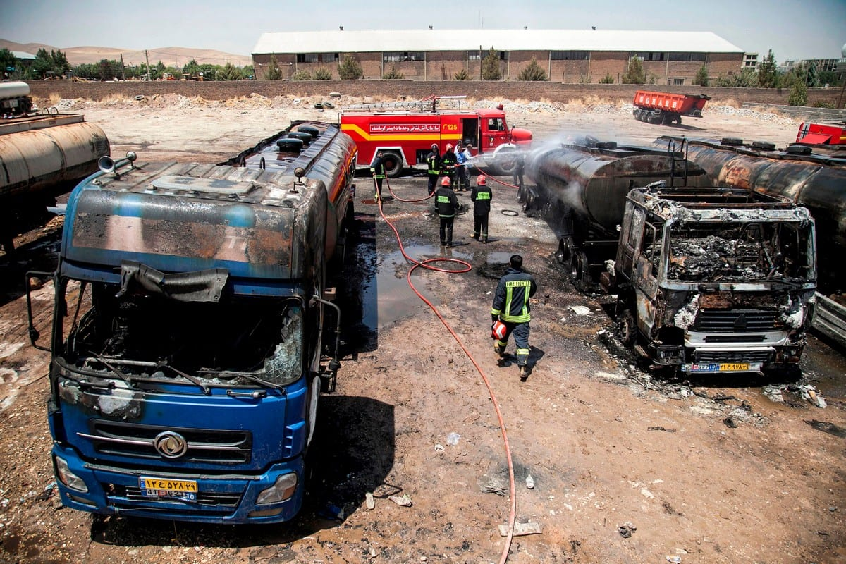 Firefighters extinguish a fire that broke out in Iran on 28 July 2020 [FARZAD MENATI/TASNIM NEWS/AFP/Getty Images]