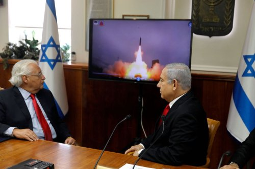 Israeli Prime Minister Benjamin Netanyahu (R) and US Ambassador to Israel David Friedman watch a video which shows the launch of the Arrow 3 hypersonic anti-ballistic missile during a cabinet meeting in Jerusalem on 28 July 2019. [MENAHEM KAHANA/AFP via Getty Images]