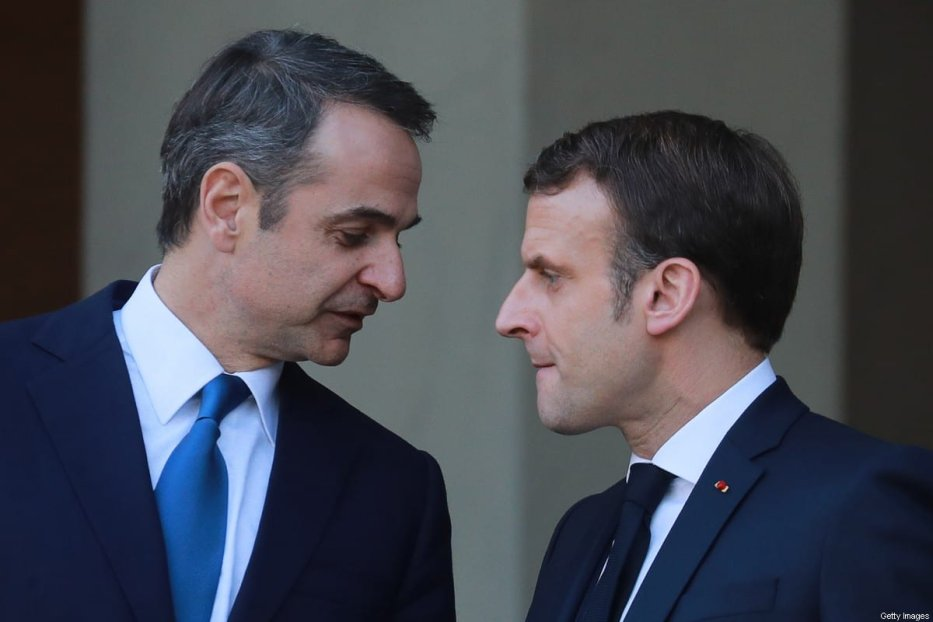 French President Emmanuel Macron (R) and Greek Prime Minister Kyriakos Mitsotakis speak following their meeting at the Elysee Palace in Paris on January 29, 2020 [LUDOVIC MARIN/AFP via Getty Images]