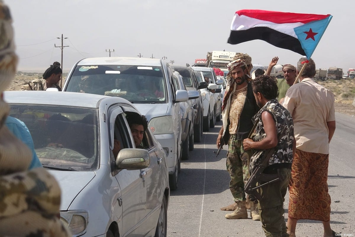 Fighters loyal to Yemen's separatist Southern Transitional Council (STC) reopen a highway in the southern Abyan province on 18 May 2020, following a three-hour ceasefire deal between pro-government troops and separatist forces. [NABIL HASAN/AFP via Getty Images]