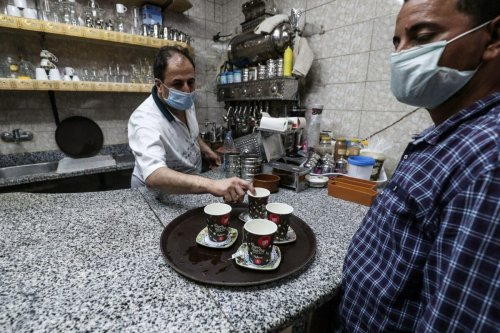 A worker prepares an order at a cafe in the Egyptian capital Cairo on June 27, 2020, [MOHAMED EL-SHAHED/AFP via Getty Image]