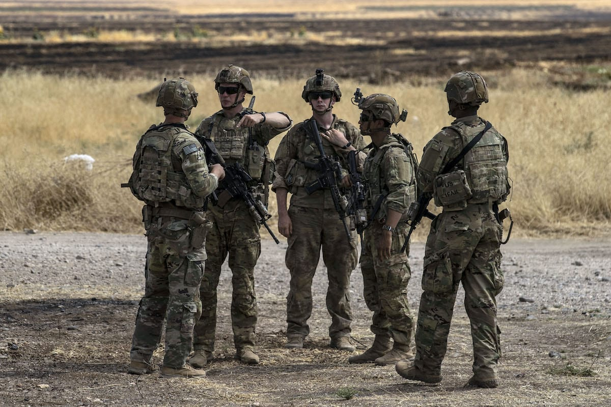 US soldiers stand at an oil field in the countryside of al-Qahtaniyah town in Syria's northeastern Hasakeh province near the Turkish border, on 4 August 2020. [DELIL SOULEIMAN/AFP via Getty Images]