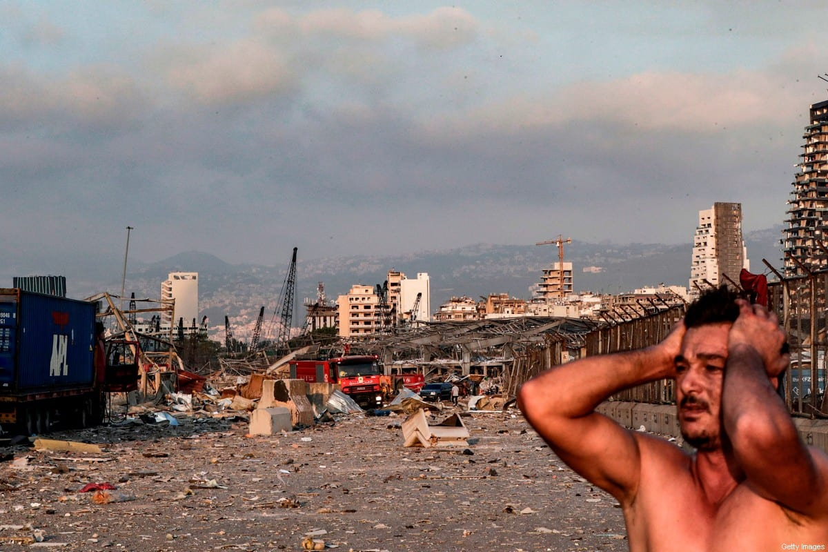 A man reacts at the scene of an explosion at the port in Lebanon's capital Beirut on August 4, 2020 [IBRAHIM AMRO/AFP via Getty Images]