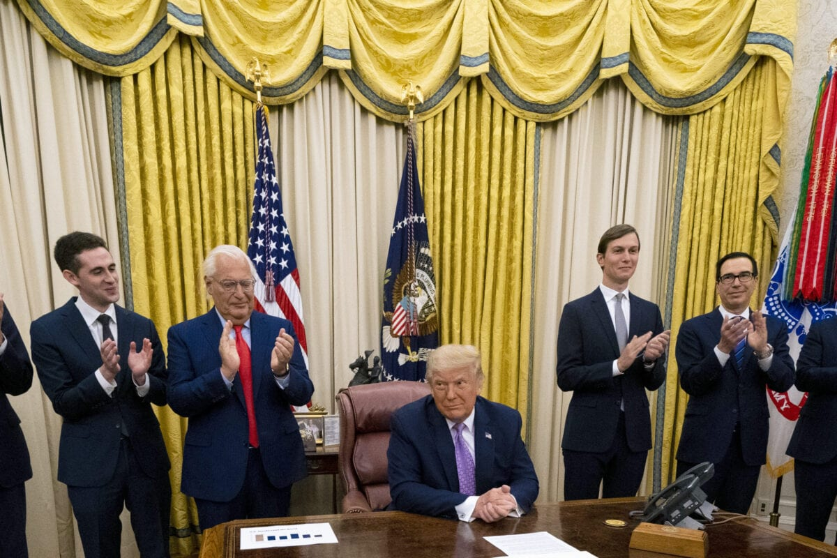 US President Donald Trump leads a meeting with leaders of Israel and UAE announcing a peace agreement to establish diplomatic ties with Israel and the UAE, in the Oval Office of the White House on 13 August 2020 in Washington, DC. [Doug Mills-Pool/Getty Images]