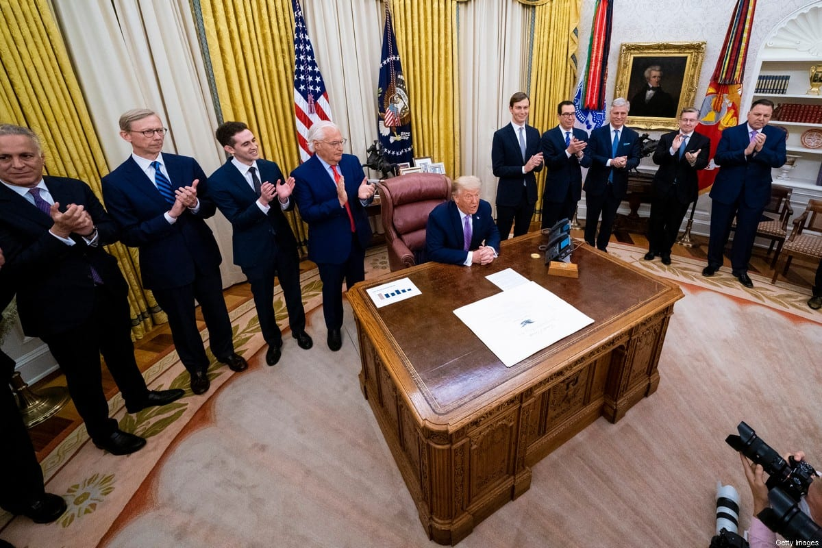 US President Donald Trump speaks during a meeting with leaders of Israel and UAE announcing a peace agreement to establish diplomatic ties with Israel and the UAE, in the Oval Office of the White House on August 13, 2020 in Washington, DC [Doug Mills-Pool/Getty Images]