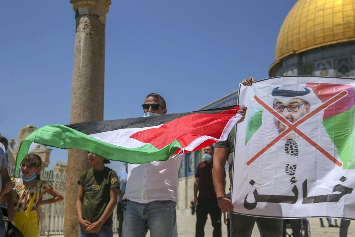 Palestinian protesters prepare to tear apart a portrait of Abu Dhabi Crown Prince Sheikh Mohammed bin Zayed al-Nahyan on August 14, 2020 at the al-Aqsa mosque compound in Jerusalem, during a protest against a US-brokered deal between Israel and the UAE to normalise relations [-/AFP via Getty Images]