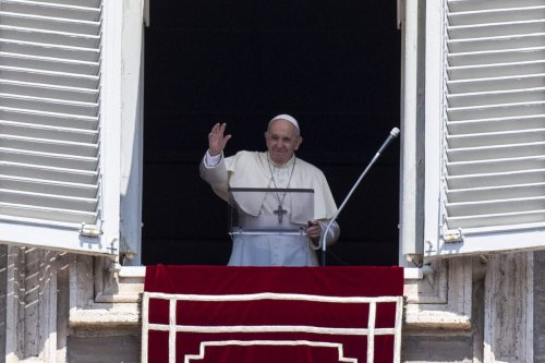 Pope Francis waves at faithfuls from the window of the apostolic palace overlooking St.Peter's square during his Angelus prayer on August 15, 2020 at the Vatican [TIZIANA FABI/AFP via Getty Images]