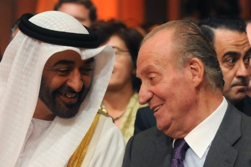 Crown Prince of Abu Dhabi Sheikh Mohammed bin Zayed Al Nahyan (L) speaks with Spanish King Juan Carlos (R) during the inauguration of the Torresol Energy Gemasolar thermasolar plant in Fuentes de Andalucia near Sevilla, southern Spain, on 4 October 2011. [CRISTINA QUICLER/AFP via Getty Images]