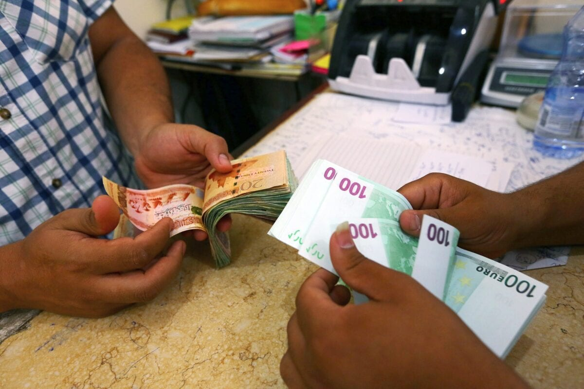 Currency is changed at a currency exchange in the Souk il-Jumaa district, in the center of the Libyan capital Tripoli, on August 20, 2014. [MAHMUD TURKIA/AFP via Getty Images]