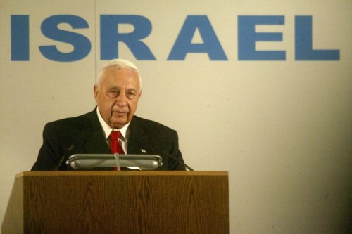 Israeli Prime Minister Ariel Sharon welcomes French Jewish immigrants July 28, 2004 on their arrival at Israel's Ben Gurion Airport near Tel Aviv [Uriel Sinai/Getty Images]