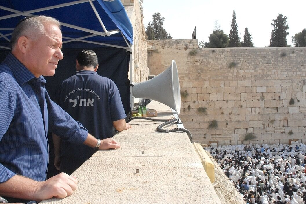 The Chairman of the Israeli Knesset's Foreign Affairs and Defence Committee Avi Dichter celebrates the holiday of Sukkot at the Western Wall September 30, 2007 in Jerusalem, Israel. [Moshe Milner/GPO via Getty Images]