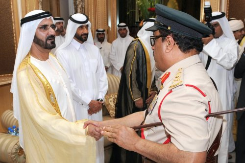 Sheikh Mohammed bin Rashid al-Maktoum (L), Vice President and Prime Minister of the United Arab Emirates and Ruler of Dubai, and his brother Sheikh Ahmed bin Rashid al-Maktoum (2nd L), greet Lieutent General of Dubai Police, Dhahi Khalfan Tamim (R), at the Zabeel Palace in Dubai on 30 September 2008 on the occasion of Eid Al-Adha. [AFP via Getty Images]