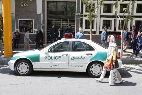 An Iranian police vehicle is seen parked outside a currency exchange shop in the capital Tehran on April 10, 2018 [ATTA KENARE/AFP via Getty Images]