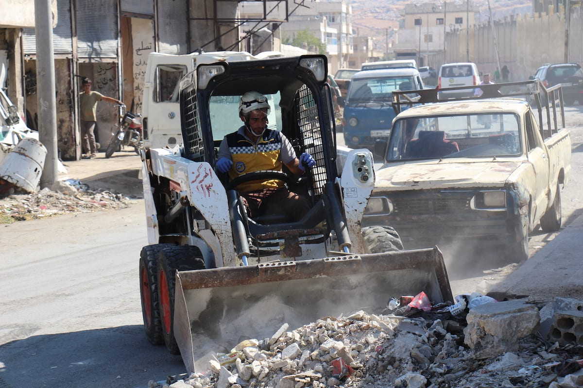 Members of the Syrian Civil Defence (White Helmets) carry out cleaning works at streets after Assad regime forces' attacks in Idlib, Syria on 24 September 2020. [White Helmets - Anadolu Agency]