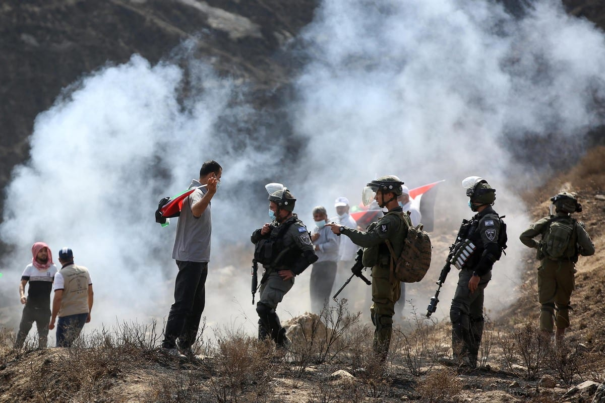Israeli security forces intervene as Palestinian demonstrators staging a protest against planned construction of Jewish settlements, by trying to plant olive trees in their own lands, at Asira al-Qibliya district of Nablus, West Bank on September 25, 2020 [Issam Rimawi - Anadolu Agency]