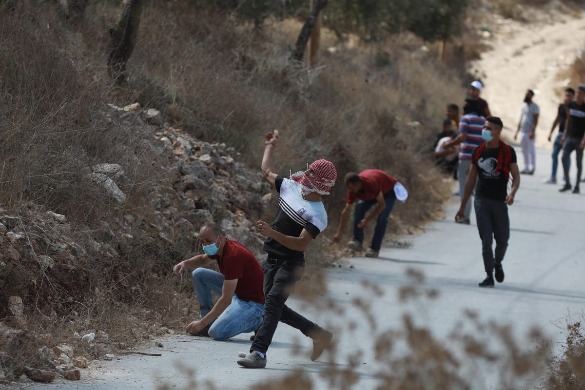 Israeli security forces intervene as Palestinian demonstrators staging a protest at Asira al-Qibliya district against planned construction of Jewish settlements, by trying to plant olive trees, in Nablus, West Bank on September 25, 2020 [Issam Rimawi - Anadolu Agency]