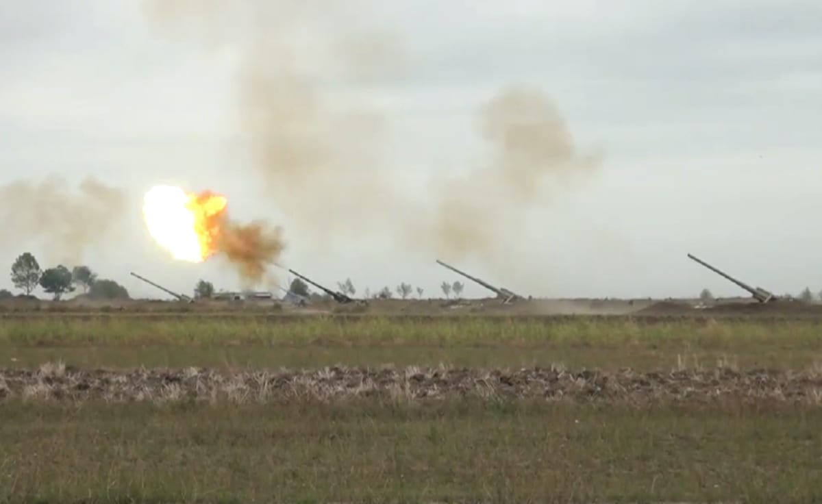 The image shared by Azerbaijan Defence Ministry shows howitzers firing munitions towards Armenian positions after the launch of a counter then a forward operation on 28 September 2020. [AZE Defence Ministry - Anadolu Agency]