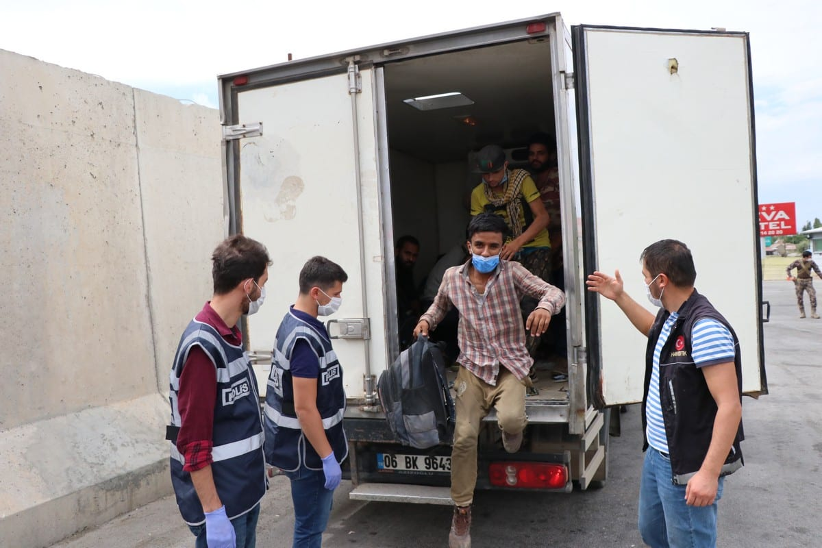 58 irregular migrants who hid in a trailer and entered the country illegally, caught by the police in Erzincan, Turkey on September 02, 2020 [Kemal Özdemir/Anadolu Agency]
