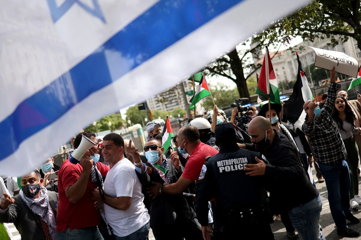 A protest against the signing of the Abraham Accords that will normalise relations between Israel, Bahrain and the UAE outside the White House, US on 15 September 2020 [Win McNamee/Getty Images]