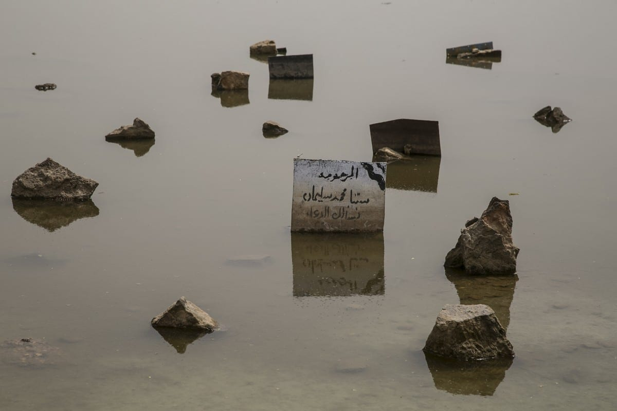 A sign is seen amid a submerged area after flash floods hit Khartoum, Sudan on 13 September 2020 [Mahmoud Hjaj/Anadolu Agency]