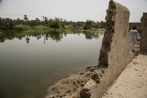 A general view of a damaged building is seen near a submerged area after flash floods hit Merove town of Khartoum, Sudan on 13 September 2020. [ Mahmoud Hjaj - Anadolu Agency]