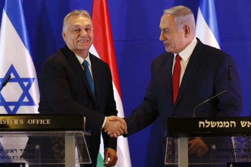 Hungarian Prime Minister Viktor Orban (L) and Israeli Prime Minister Benjamin Netanyahu shake hands during a press conference after their meeting in Jerusalem on February 19, 2019 [ARIEL SCHALIT/AFP via Getty Images]