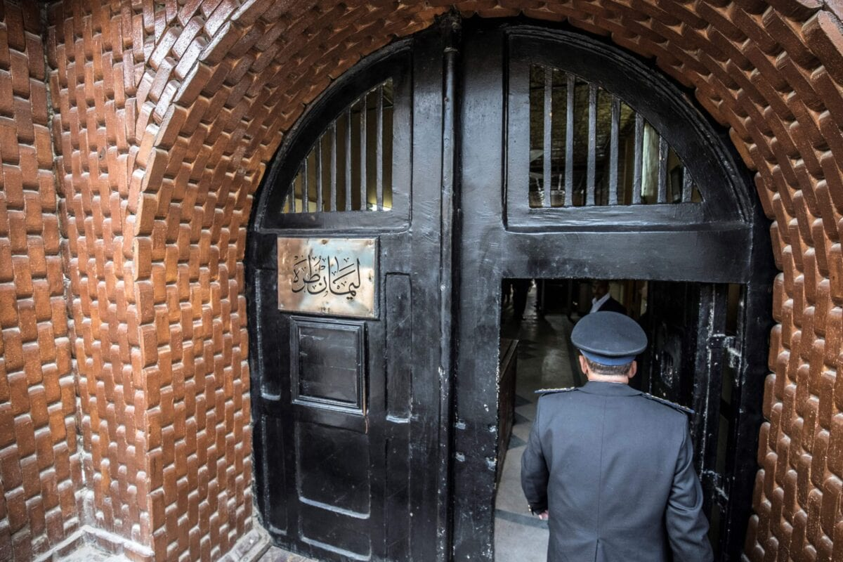 A picture taken during a guided tour organised by Egypt's State Information Service on February 11, 2020, shows an Egyptian police officer entering the Tora prison in the Egyptian capital Cairo. [KHALED DESOUKI/AFP via Getty Images]