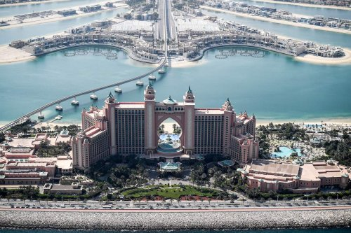 An aerial view of the Atlantis The Palm, luxury hotel resort located at the apex of the man-made Palm Jumeirah archipelago off the Gulf emirate of Dubai, during a government-organised helicopter tour on July 8, 2020 [KARIM SAHIB/AFP via Getty Images]