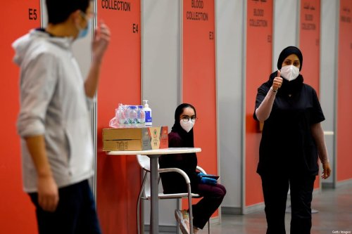 A nurse gives a thumbs up at Manama's repurposed convention centre, in which 6,000 people are participating in a large-scale trial of a Chinese-sponsored vaccine for the Covid-19 coronavirus, on August 27, 2020 in the Bahraini capital [MAZEN MAHDI/AFP via Getty Images]