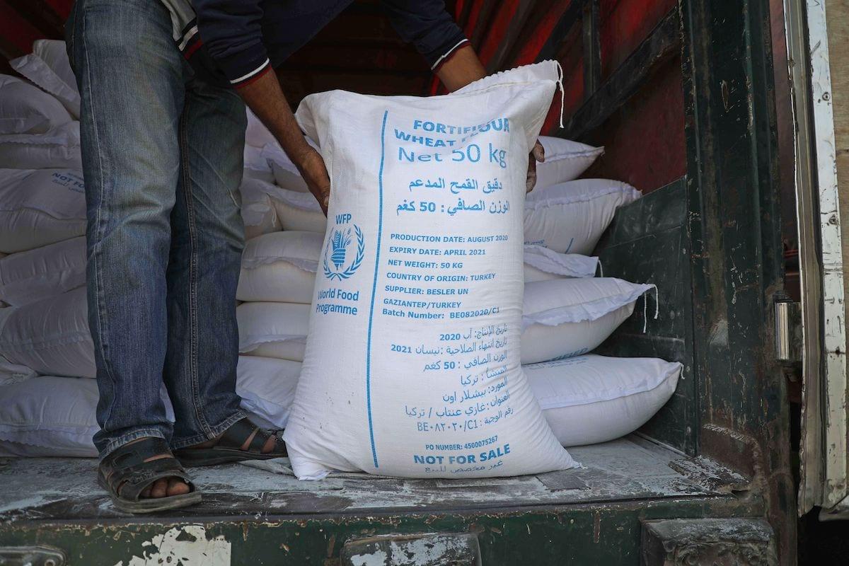 International humanitarian aid trucks cross into Syria's northwestern Idlib province through the Bab al-Hawa border crossing with Turkey, on 7 September 2020. [AAREF WATAD/AFP via Getty Images]