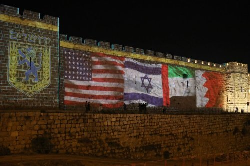 The flags of US, Israel, United Arab Emirates, and Bahrain are projected on the ramparts of Jerusalem's Old City on September 15, 2020 in a show of support for Israeli normalisation deals [MENAHEM KAHANA/AFP via Getty Images]