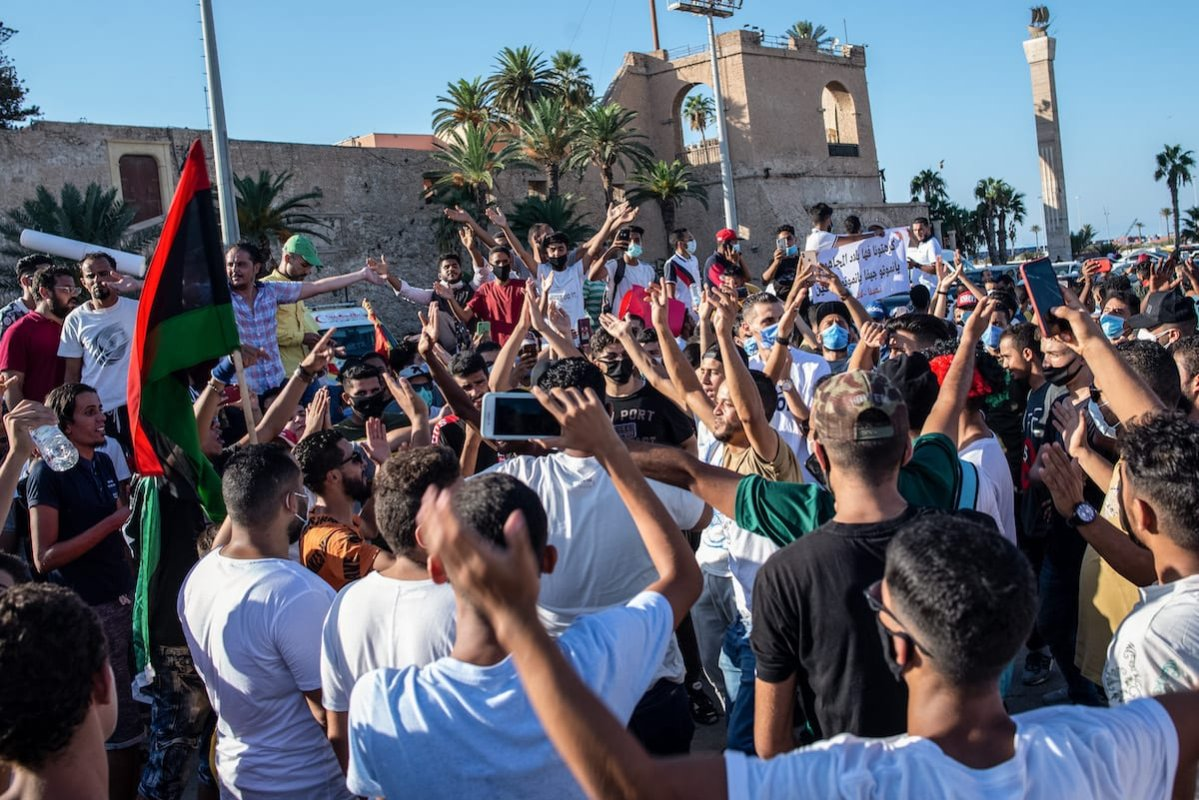 Men protest against corruption and poor living conditions in Martyr's Square on 23 August 2020 in Tripoli, Libya. [Nada Harib/Getty Images]