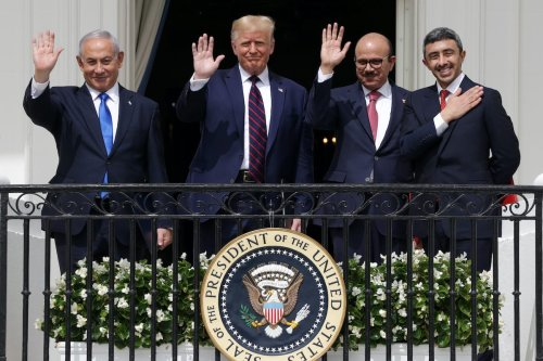 (L-R) Prime Minister of Israel Benjamin Netanyahu, US President Donald Trump, Foreign Affairs Minister of Bahrain Abdullatif bin Rashid Al Zayani, and Foreign Affairs Minister of the United Arab Emirates Abdullah bin Zayed bin Sultan Al Nahyan wave from the Truman Balcony of the White House after the signing ceremony of the Abraham Accords on the South Lawn of the White House on 15 September 2020 in Washington, DC. [Alex Wong/Getty Images]