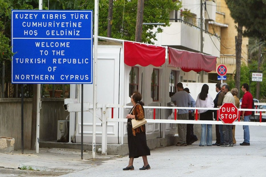 People que to obtain a visa to enter the Turkish Republic of Northern Cyprus in the UN Buffer Zone that seperates the Turkish and Greek sides of Nicosia on April 24, 2004 in Nicosia, Cyprus [Scott Barbour/Getty Images]