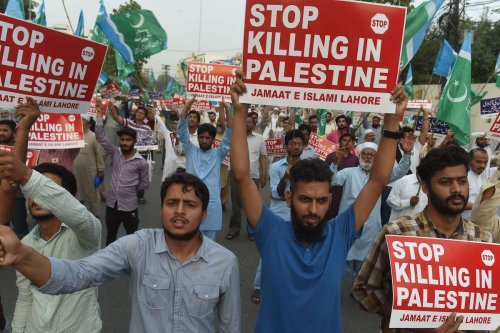 Pakistani supporters of the Jamaat-e-Islami (JI) organisation hold placards as they march during a protest against US and Israel in Karachi, on 17 May 2018 [ARIF ALI/AFP via Getty Images]