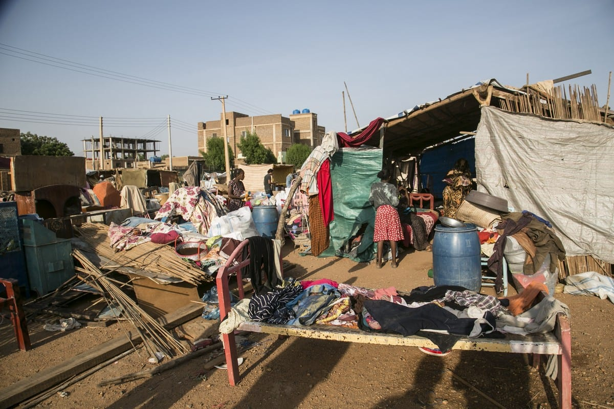 Sudanese people take shelter at a make shift camp following floods that ruined their homes in Khartoum, Sudan on 8 September 2020 [Mahmoud Hjaj/Anadolu Agency]
