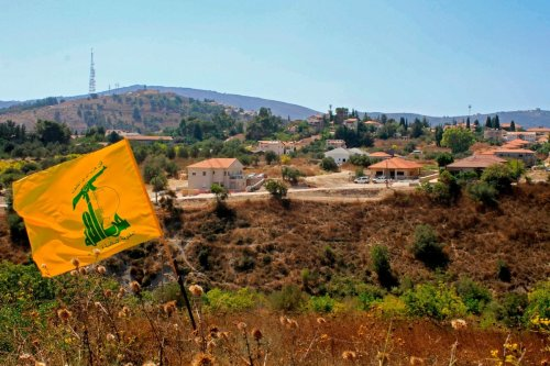 A Hezbolla flag flutters in Lebanon on 2 September 2019 [MAHMOUD ZAYYAT/AFP/Getty Images]