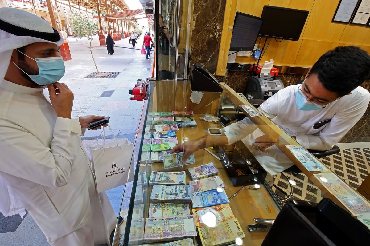 A Kuwaiti man stops at a currency exchange shop in Kuwait City on 7 September 2020 [YASSER AL-ZAYYAT/AFP/Getty Images]