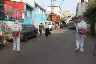 A picture of the sterilisation process in a street in Ein El-Hilweh refugee camp in Lebanon [Reporters for Investigative Journalism (ARIJ)]